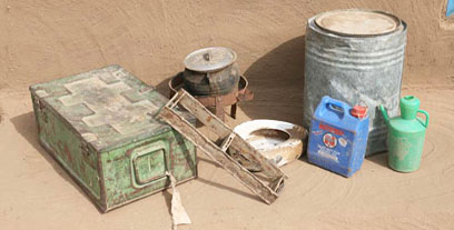 Various containers, a mudbrick mould, stove and bedpan