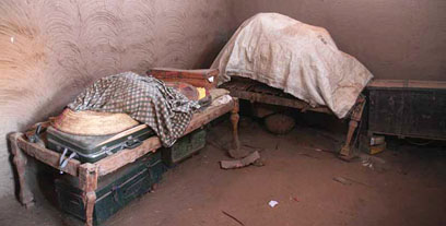 Storeroom during clearance, with traditional beds (angareeb)