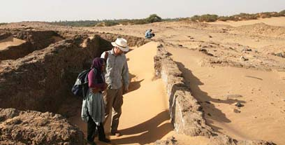 Shadia Abdu Rabo, antiquities inspector, with Neal Spencer, in 20th dynasty house (about 1100 BC).