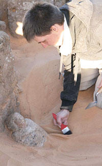 Project team member René Kertesz revealing the sandstone bust