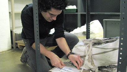 Conservator Jamie Hood labelling one of the cauldrons for transportation