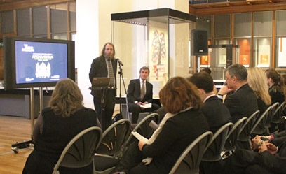 Exhibition curator, St John Simpson, discusses the objects at a press conference