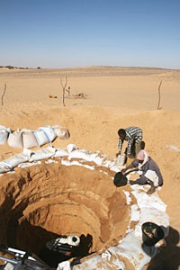 Pit dug through the ancient Nile channel at Amara West