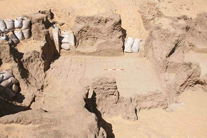 Paved court with stone doorways (D13.3.1) in course of excavation