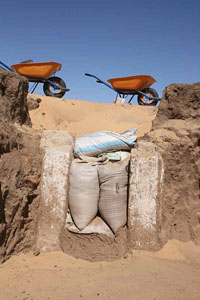 The architecture of excavation – sandbags keeping sand out of the deep trench