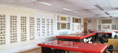 The conservation studio with hanging scrolls on the walls