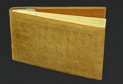 The leather-bound catalogue, decorated with Egyptian motifs, which JJ Colman commissioned for his collection. The shroud is listed here. © Norwich Castle Museum and Art Gallery