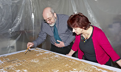 John Taylor and Faye Kalloniatis from Norwich Castle Museum examine the text. © Norwich Castle Museum and Art Gallery / Trustees of the British Museum