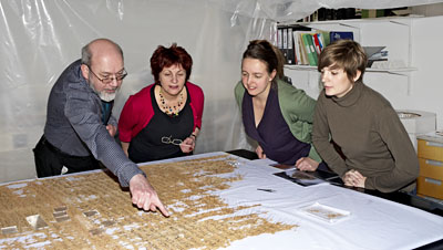 British Museum curator John Taylor examines the text for the first time with Norwich Castle Museum research associate Faye Kalloniatis, British Museum conservator Monique Pullan and textile conservation intern Melina Plottu. © Norwich Castle Museum and Art Gallery / Trustees of the British Museum