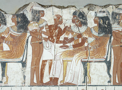 Wall painting from the eighteenth dynasty tomb chapel of Nebamun. The skin of the central seated figure and male slave are coloured with red ochre © Trustees of the British Museum