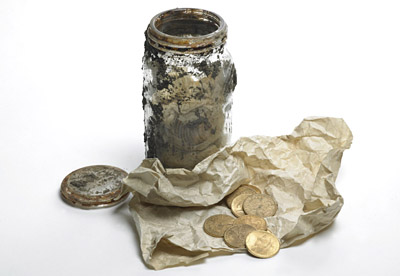 The coins were found wrapped in greaseproof paper, in a jar. © Portable Antiquities Scheme