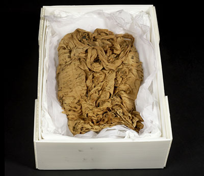 The Norwich Shroud before conservation and research. © Norwich Castle Museum and Art Gallery / Trustees of the British Museum