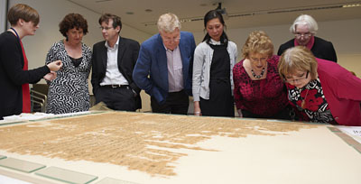 Visitors to the Study day examine the shroud as Melina Plottu (far left), British Museum conservation intern, explains the techniques used to conserve the shroud. © Norwich Castle Museum and Art Gallery / Trustees of the British Museum