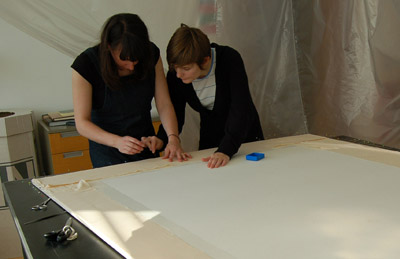 Covering the acid-free final support board with cotton fabrics. © Norwich Castle Museum and Art Gallery / Trustees of the British Museum