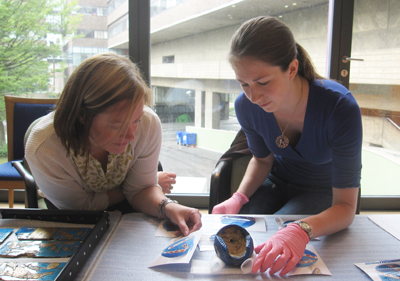 Margaret Maitland from the British Museum and Rachel Metcalfe from Tyne & Wear Archives and Museums check each object.