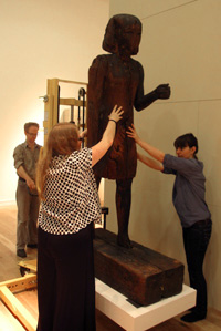 Museum assistants from the British Museum move Ramses I into position.
