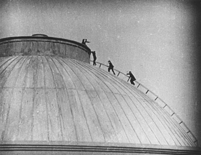 Actors, seemingly on the roof of the British Museum Reading Room. © 1929 STUDIOCANAL Films Ltd.