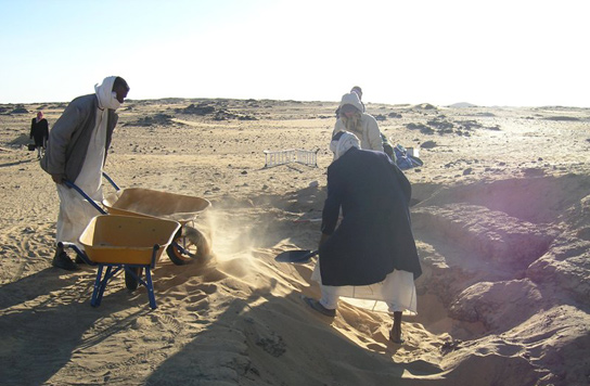 Removing sand from the chapel of G309