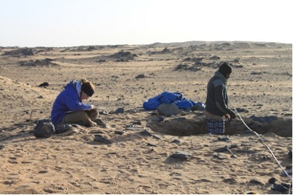 Planning of G308 during excavation, with Åshild and fellow Field School participant Mohamed Saad