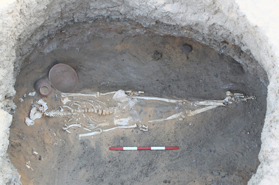Lower burial with ceramic vessels placed by the head