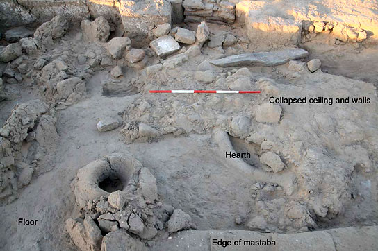 Room two in house E13.8, with partly excavated rubble above hearth and floor