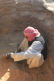 Hassan Awad, cleaning the shaft of G310. Behind is what we thought was the opening to a burial chamber…