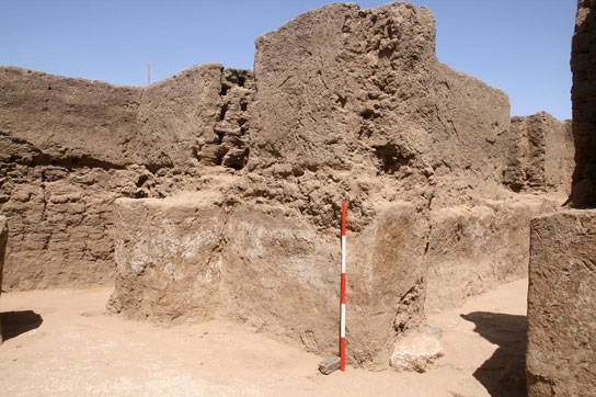 View of white-painted walls in house E13.7, with walls of later E13.4 above
