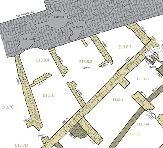 Plan of house E13.8, with town wall at top