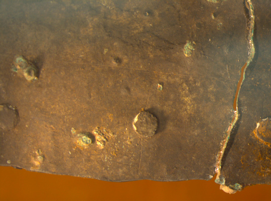 Faint incised lines marking-out the position of rivets