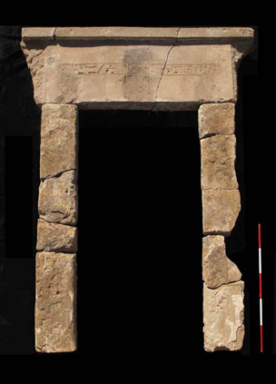 Reconstructed sandstone door to room three of house E13.6