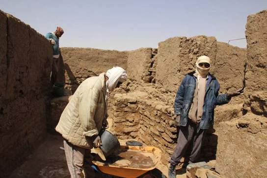 Ghazafi Mohamed and Hassan Nouri constructing protective walls in house E13.7
