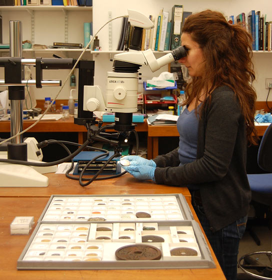 Examining coins in the lab