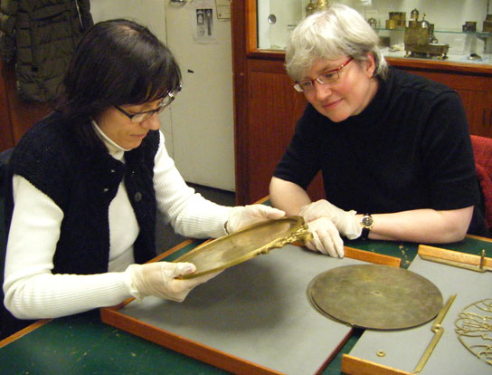 Josefina Rodríguez Arribas (left) and Silke Ackermann examining an astrolabe