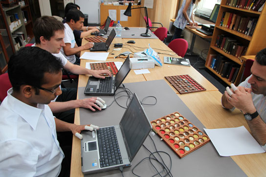 Volunteers from Citi adding objects to the database