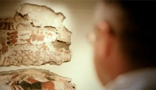 British Museum curator, Richard Parkinson looking at a tomb-painting