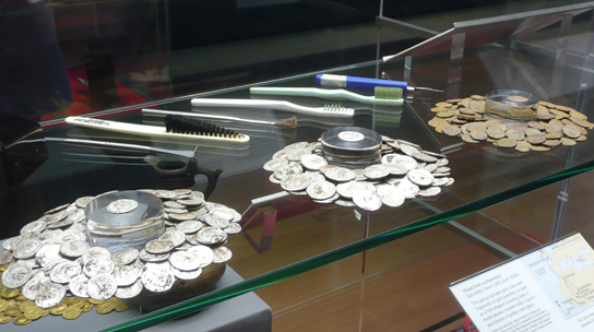 Parts of the hoard and some of the tools used by conservator Julia Tubman to excavate it on display