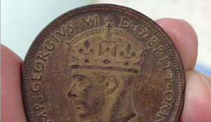 counterfeit 1938 two shilling West African Currency Board coin