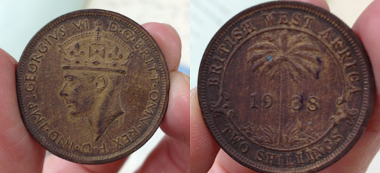 The obverse (left) and reverse (right) of a counterfeit 1938 two shilling West African Currency Board coin found at the National Archives (UK).