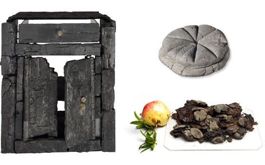 Carbonised furniture and food © Soprintendenza Speciale per i Beni Archeologici di Napoli e Pompei.