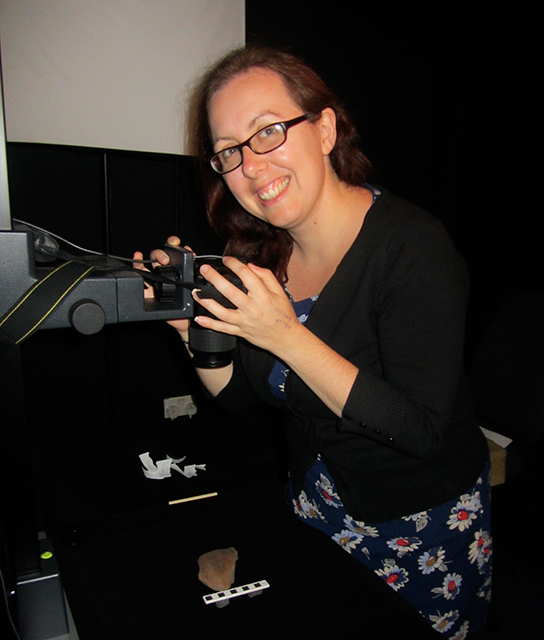 Jennifer Cromwell, Postdoctoral Fellow in Ancient Egypt and Sudan, photographing ostraca from Wadi Sarga