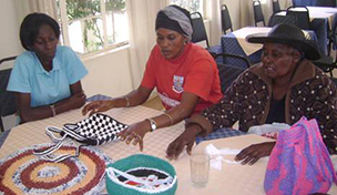 Pamoja women's group displaying crafts made for sale in Kenya in 2011. © Ndunge Kiiti.