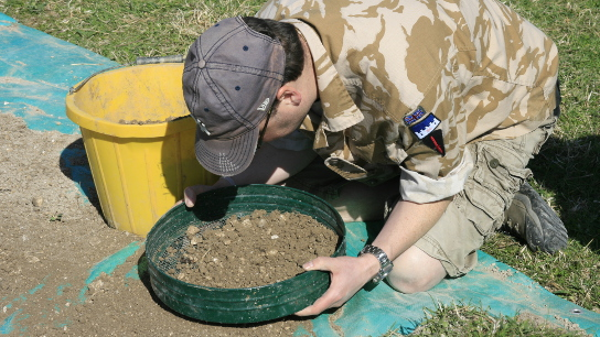 Author sieving at the site of a Bronze Age hoard found by a metal-detectorist
