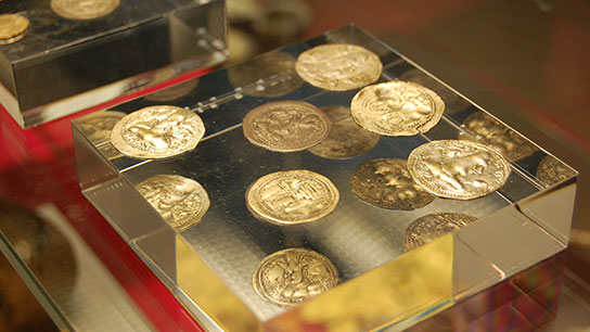 Coins from the relic deposit at Tope Kelan on display in the Citi Money Gallery