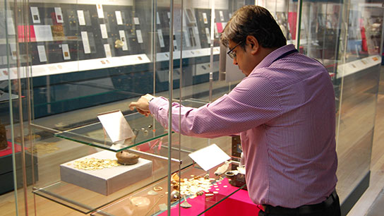 Mahesh working on the display in the Citi Money Gallery