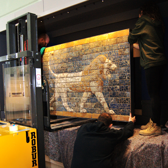 The lion panel being installed in Room 55