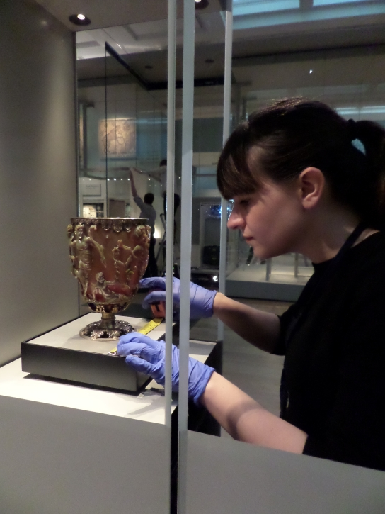 The Lycurgus cup being installed by project curator Rosie Weetch in Room 41