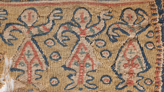 Detailed macro shot of a multi-coloured tapestry panel, depicting three stylized human figures (EA 37131). Egypt, 4th-7th century AD