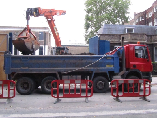 The lorry is then filled with clay by a telescopic digger.