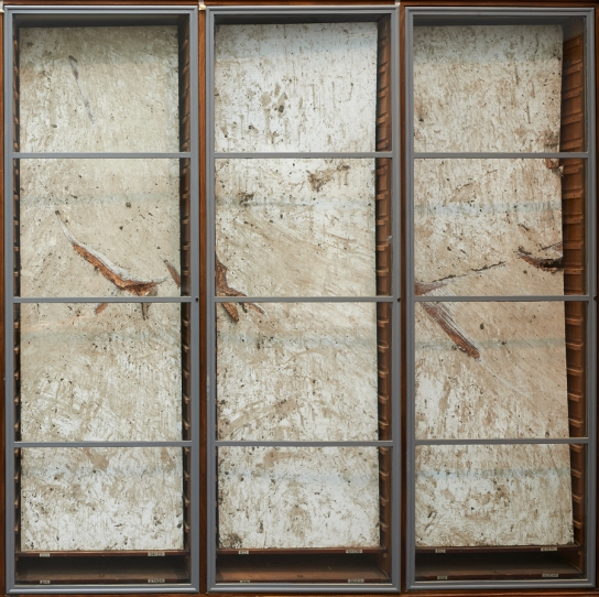 The final result displayed in the museum cabinets that the boards were cut to fit.