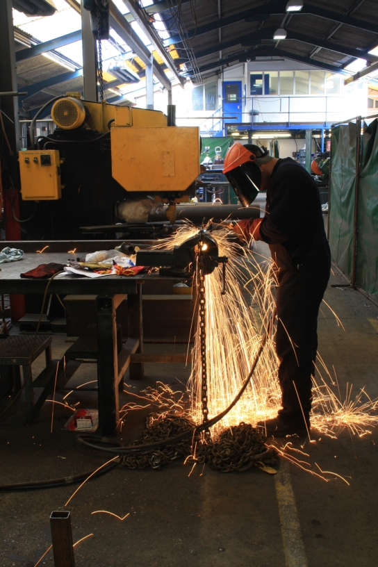 The chain being separated into its 800 individual links by gas torch by PAD contractors.